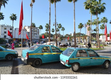 """TANGIER, MOROCCO - NOVEMBER 9, 2015: Petits Taxis (Eng. """"small taxis"""") at Grand Socco (officially know as Place du Grand 9 Avril 1947), a square in Tangier"""