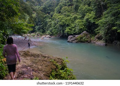 Tangkahan, North Sumatera/Indonesia- September 2018: Some travellers are enjoying Tangkahan with its beautiful rivers with pebbles and green trees. Tangkahan is known as hidden paradise in Sumatera.