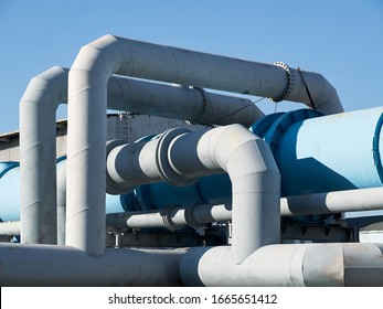 Tangle of pipes. Concept of complexity of petrochemical industry communications. Pipe weaving of various diameters with expansion joints and flanges