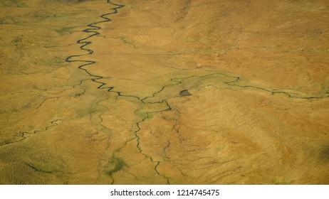 A  tangle of winding rivers below a ridge on the Skye Trail in the Isle of Skye Scotland