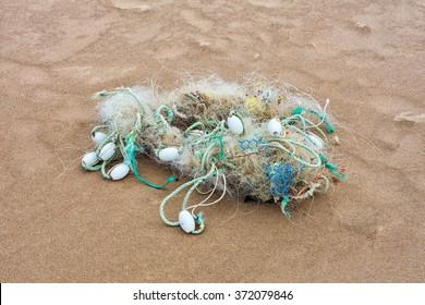 Tangled abandoned marine debris on the Gower peninsula, Swansea