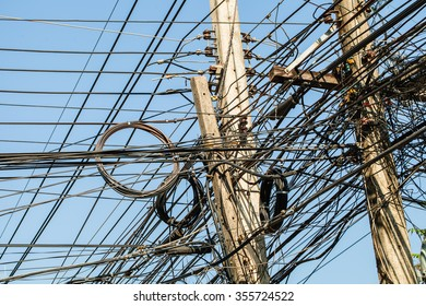 Tangled Electrical Wire on Electricity Post, Disarrangement Concept