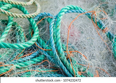 A tangled mess of fishing nets plastic rope and other debris washed up on a coastal beach ideal for an ecological hazard or pollution concept