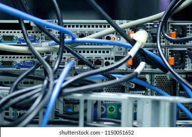 Tangled network cables and wires in server room for Unorganized cabling in data center concept