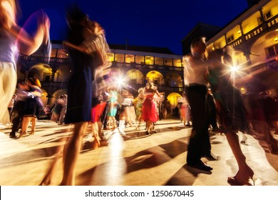 Tango danced inside a courtyard by evening