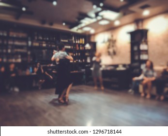 Tango dancing couple, legs in motion, snapshot in close. Blure effect.