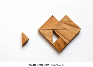 Tangram puzzle wait for fulfill to heart shape on white background