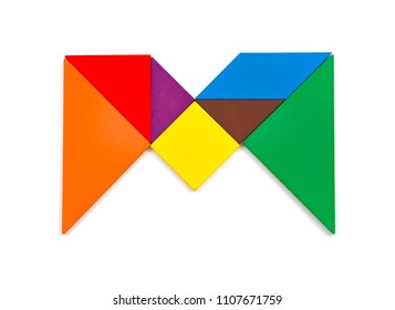 tangram shaped like a letter M on white background