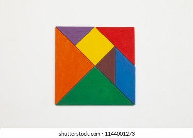 Tangram. Traditional Chinese dissection puzzle, seven tiling pieces - geometric shapes: triangles, square (rhombus), parallelogram. Board game for kids that helps to develop analytical skills.