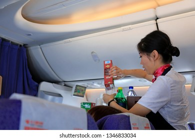 Tangshan City - August 28, 2018: stewardess prepares drinks for passengers on plane, Tangshan City, Hebei Province, China