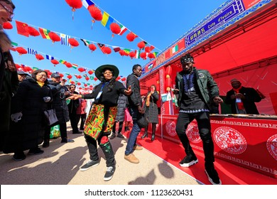 Tangshan City - February 4, 2018: foreign students from Zimbabwe Bleetary and her friends in West Africa Dance on the streets to share the Chinese Lunar New Year, Tangshan City, H