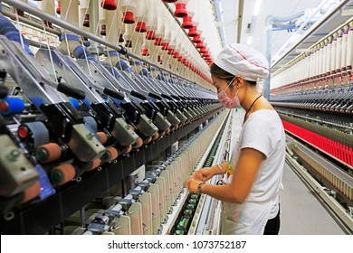 Tangshan City - January 4, 2018: workers are busy at the spinning line, Tangshan City, Hebei, China