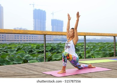 Tangshan City - September 3: a woman doing yoga exercise in the park, on September 3, 2016, tangshan city, hebei province, China.