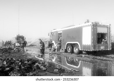 TANGSHAN - NOVEMBER 20: firefighters prepare to leave the scene of the fire fighting vehicles and personnel after the fire, November 20, 2013, tangshan city, hebei province, China.