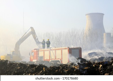 TANGSHAN - NOVEMBER 20: firefighters in sprinkler at the scene of the fire, November 20, 2013, tangshan city, hebei province, China.