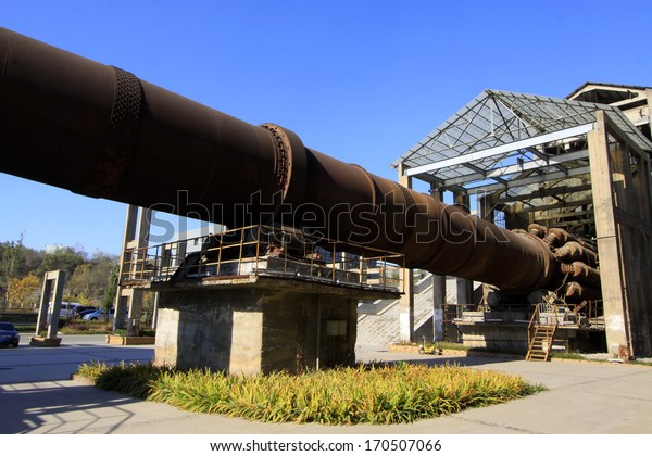 TANGSHAN - NOVEMBER 4: The abandoned rotary kiln in the Qixin cement plant on november 4, 2013, tangshan city, hebei province, China.