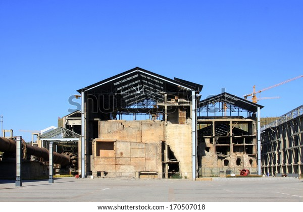 TANGSHAN - NOVEMBER 4: The disused factories in the Qixin cement plant on november 4, 2013, tangshan city, hebei province, China.