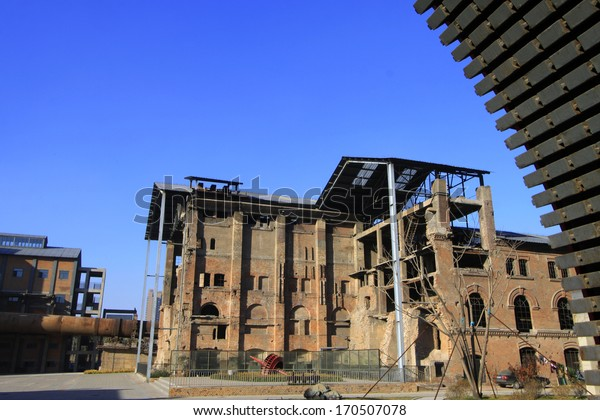 TANGSHAN - NOVEMBER 4: The gears and abandoned factories in the Qixin cement plant on november 4, 2013, tangshan city, hebei province, China.