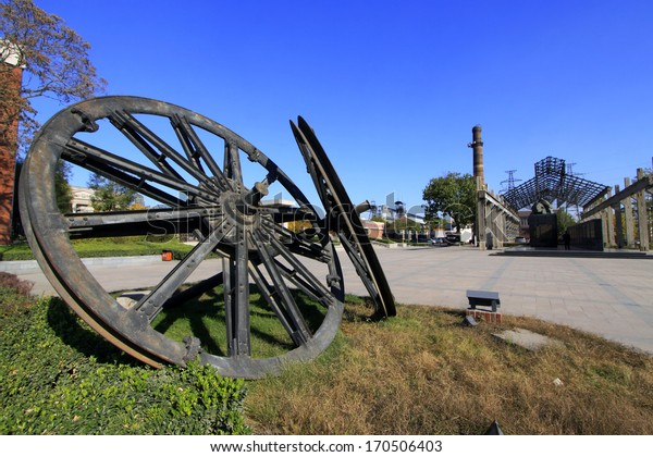 TANGSHAN - NOVEMBER 4: The giant wheel sculpture in the Kailuan national mine park on november 4, 2013, tangshan city, hebei province, China.