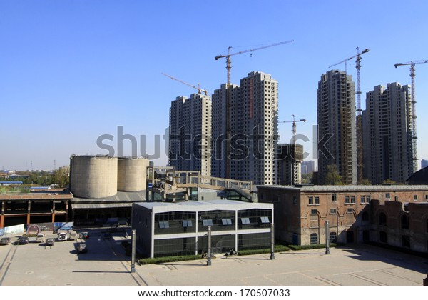 TANGSHAN - NOVEMBER 4: The old buildings and new buildings in the Qixin cement plant on november 4, 2013, tangshan city, hebei province, China.