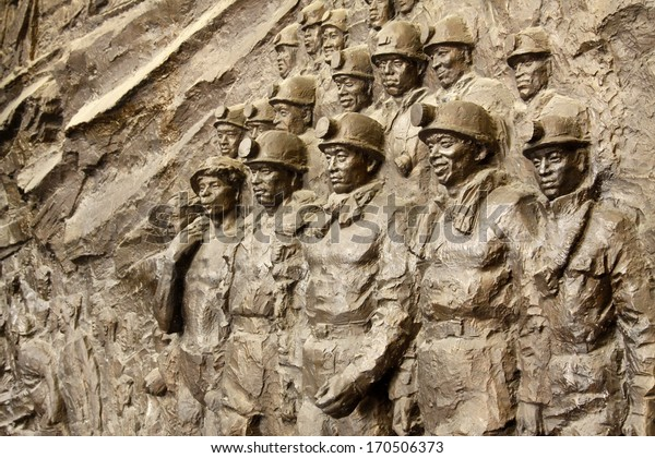 """TANGSHAN - OCTOBER 18: The """"Black River """"large-scale sculpture in kailuan national mine park on october 18, 2013, tangshan city, hebei province, China."""