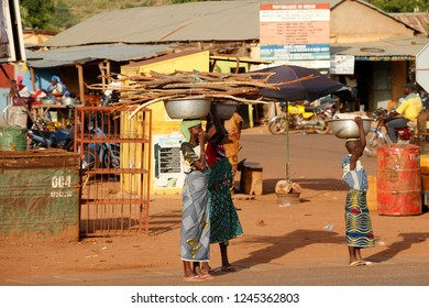 Tanguieta Benin April 12 2014 street life in the north of the country. Women with branches on their heads