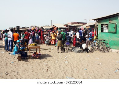 Tanji, the Gambia, april 2015; people gather on the beach in the afternoon.