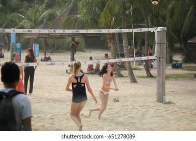 TANJONG BEACH, SENTOSA, SINGAPORE, JANUARY 26, 2015: unidentified people play beach volleyball at Australia National Day party in Tanjong Beach, Sentosa, Singapore