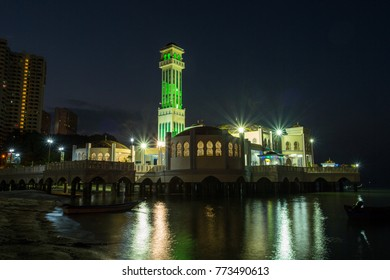 TANJUNG BUNGAH, PENANG, MALAYSIA - 18 Febuary 2016 : Floating Mosque Tanjung bungah with fisher man boat lifestyle of local at Twilight time in Penang ,Malaysia.