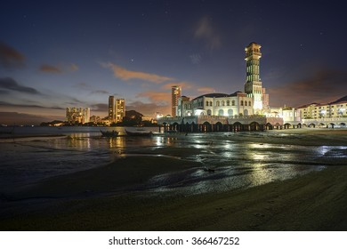 TANJUNG BUNGAH, PENANG, MALAYSIA - 21 JAN 2016 : Twilight light with star trails motion at Floating Mosque, Tanjung Bungah, Penang, Malaysia. Over exposed from street light.