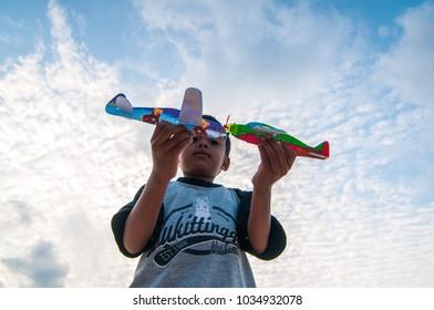 Tanjunguban -February 2018. Kids playing a gliders during sunny day at Bintan island - indonesia