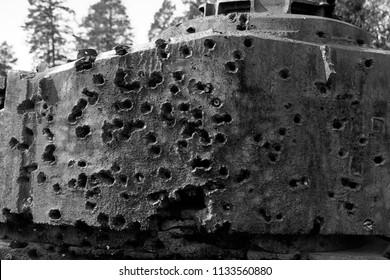 Tank gun turret of british tank Comet Mk I model B penetrated by many anti-tank rocket-propelled grenades