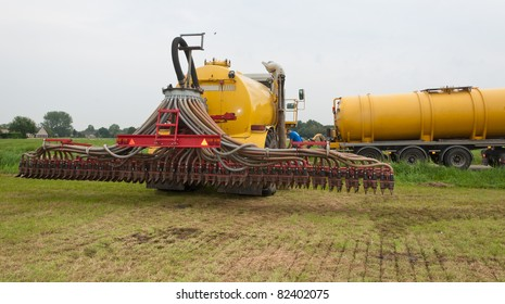The tank of the manure injector is being filled in the field