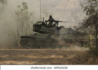 Tank, military, running, dust spread