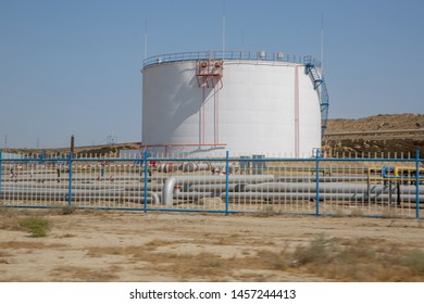 Tank and pipe sent oil. Big Industrial oil tanks in a refinery .Large white industrial tanks for petrochemical or oil or fuel or water in refinery or power plant or industrail plant .