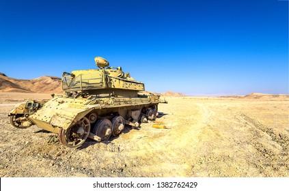 Tank in sand desert scene. Broken tank desert scene. Broken tank in desert. Tank desert view