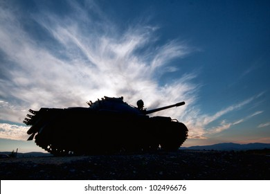 tank silhouette at sunset