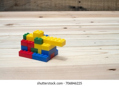 Tank Toy made from lego pieces on wooden background.