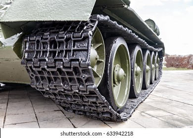 Tank tracks. A tank of the second world war. Caterpillar armored closeup shot. Black track link and large rubber-coated rollers. Chassis tank.