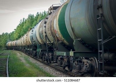Tank wagons with oil. Freight train in forest