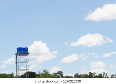 Tank of Water and blue sky background in Thailand.