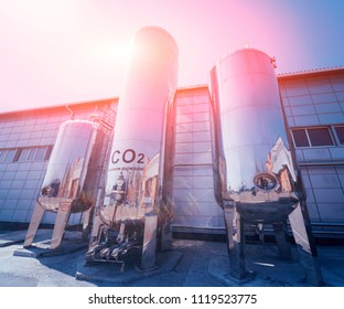 The tank with water, carbon and ladder. Equipment for beverages factory. Background
