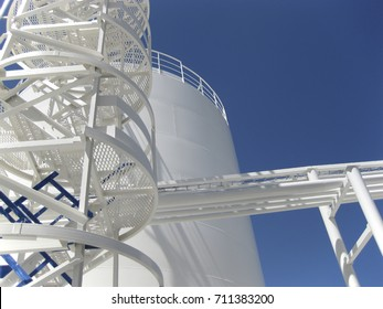 The tank with water and a ladder. Equipment for primary oil refining.