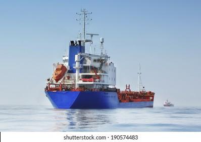 Tanker blue loaded back view  in the ocean