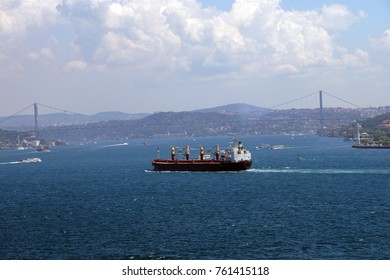 Tanker dodges commuter ferry boats on its way up the Bosphorus to thew Black Sea,  in Istanbul, Turkey