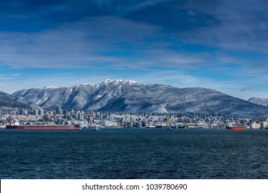 Tanker and Rocky Mountains, North Vancouver, British Colombia, Canada.