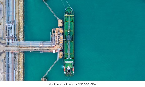 Tanker ship at the port, Oil terminal tanker ship loading, Aerial view.