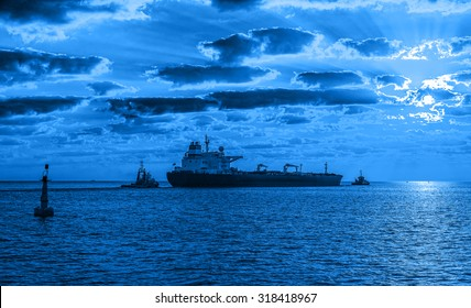 Tanker ship with tug boat on sea - Shipping concept.