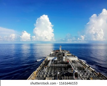 Tanker (tank ship or tankship) ship designed to transport or store liquids or gases in bulk. Types of tankship include oil tanker, chemical tanker, gas carrier. Board of lng tanker sailing in ocean