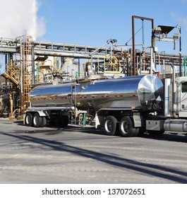 Tanker truck being loaded at a factory